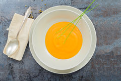 Delicious healthy pumpkin soup, spoon and napkin Royalty Free Stock Photography