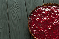 Delicious Healthy Raw Raspberry Tart from Almond Meal and Raspberries on Dark Wooden Background, Free Space for Text Royalty Free Stock Photography