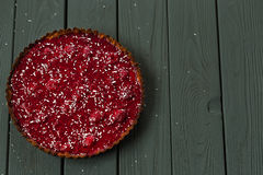 Delicious Healthy Raw Raspberry Tart from Almond Meal and Raspberries on Dark Wooden Background, Free Space for Text Royalty Free Stock Images