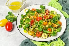 Delicious and healthy salad with beans mung and fresh vegetables. Delicious and healthy salad with beans mung, avocado, leek, cherry tomatoes, corn lettuce on Royalty Free Stock Photo