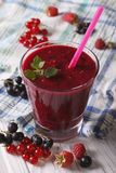 Delicious and healthy smoothies with fresh berries closeup. Vert Royalty Free Stock Images