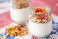 Delicious and healthy yogurt with granola stock image