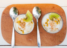 Delicious and healthy yogurt and granola and kiwi and passion fr Royalty Free Stock Photo
