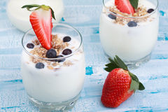 Delicious and healthy yogurt with granola or muesli with nuts, r Stock Photo