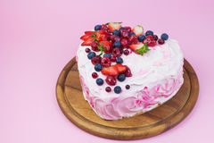 Delicious heart shaped cream cake with berries Stock Photos