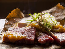 Delicious Hida Beef. Cooking the delicious Japanese Hida Beef with garlic, onion, tofu Royalty Free Stock Image