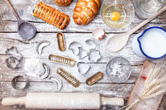 Delicious holiday baking background with ingredients and utensils Stock Photography