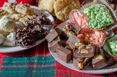 Delicious holiday treats made with love. Rice crispy treats, fudge, truffles, chocolate haystacks,  cookies and more Royalty Free Stock Photos