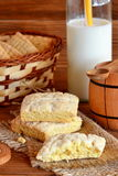 Delicious home cookies on a burlap. A bunch of biscuits in a basket. Cow's milk in a glass bottle. Stock Image