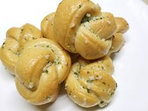 Home Made Garlic Knots 4. Delicious home made bread knots with garlic and parsley on a white background royalty free stock photos
