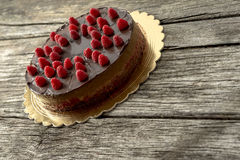 Delicious home made chocolate cake decorated with fresh raspberr Royalty Free Stock Photography