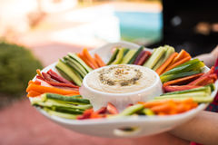 Delicious home made hummus and vegetables sticks stock photos