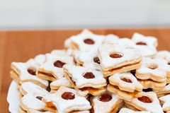 Delicious home made jam cookies. On simple plate and table with plain background royalty free stock photos