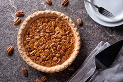 Pecan Pie. A delicious home made pecan pie on a stone counter top stock image