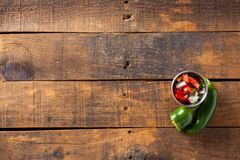 A delicious home made salsa pico de gallo with tomato, onion, li. Me, cilantro, and jalapeno pepper served on rustic wooden table. Selective Focus With Copy stock photos