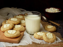Delicious homemade biscuits. Shortbread with cream cheese cookie and glass of milk on dark background. Royalty Free Stock Images