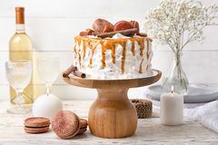 Delicious homemade cake with caramel sauce. And cookies on table Royalty Free Stock Images