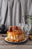 Delicious homemade cake with caramel sauce. And popcorn on table Stock Photography