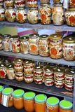Delicious homemade canned mushrooms haricots and nuts. Canned of tasty ceps haricots nuts and mushrooms on counter. Delicious homemade canned mushrooms haricots Royalty Free Stock Photography