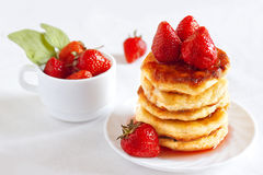 Delicious homemade carnival cheese pancakes. With strawberry poured with jam Stock Photography