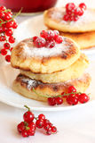 Delicious homemade cheese pancakes. With berries and redcurrant. Sprinkled with powdered sugar Stock Photos