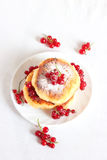 Delicious homemade cheese pancakes. With berries and redcurrant. Sprinkled with powdered sugar Stock Images