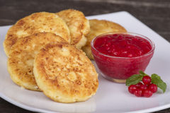 Delicious homemade cheese pancakes with berry jam in white plate Stock Photo