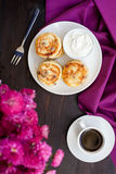 Delicious homemade cheese pancakes with black coffee Royalty Free Stock Photos
