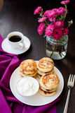 Delicious homemade cheese pancakes with black coffee Stock Photo