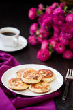 Delicious homemade cheese pancakes with black coffee Royalty Free Stock Images