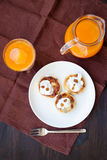 Delicious homemade cheese pancakes with fresh carrot juice Royalty Free Stock Image