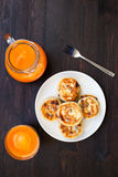 Delicious homemade cheese pancakes with fresh carrot juice Royalty Free Stock Photo