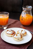 Delicious homemade cheese pancakes with fresh carrot juice Stock Photography