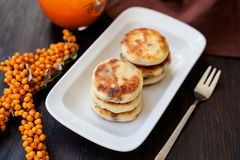 Delicious homemade cheese pancakes with fresh carrot juice Royalty Free Stock Images