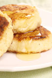 Delicious homemade cheese pancakes with honey Stock Photography
