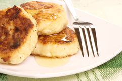 Delicious homemade cheese pancakes with honey Royalty Free Stock Images