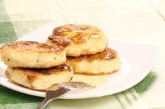 Delicious homemade cheese pancakes with honey Stock Photo
