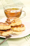 Delicious homemade cheese pancakes with honey Stock Image