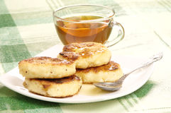 Delicious homemade cheese pancakes with honey Royalty Free Stock Photo