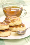 Delicious homemade cheese pancakes with honey Stock Images