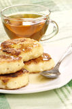 Delicious homemade cheese pancakes with honey Royalty Free Stock Image