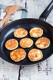 Delicious homemade cheese pancakes with raisin in a pan Royalty Free Stock Photos