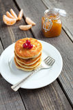 Delicious homemade cheese pancakes with raisin, tangerine jam an Royalty Free Stock Images