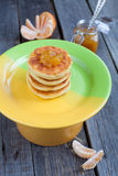 Delicious homemade cheese pancakes with raisin, tangerine jam an Stock Image