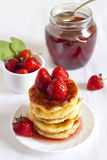 Delicious homemade cheese pancakes. With strawberry poured with jam Stock Photo