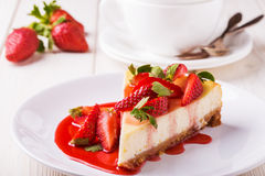 Delicious homemade cheesecake with strawberries royalty free stock photography