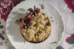 Delicious homemade cherry pie on floral tablecloth Royalty Free Stock Photography