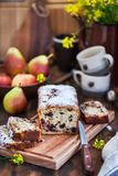Delicious homemade chocolate and pears loaf cake. On rustic wooden background royalty free stock photo