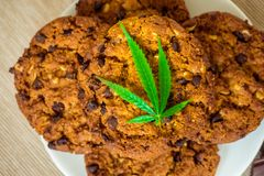 Delicious homemade Cookies with CBD cannabis and leaf garnish an Stock Photos