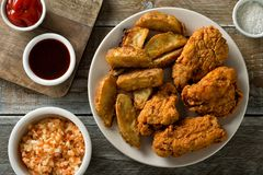 Crispy Fried Chicken. Delicious homemade crispy fried chicken with taters and coleslaw Royalty Free Stock Photo